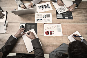 Brainstorm against business interface with graphs and data