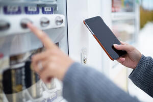 Woman use of soft drink vending system paying by cellphone-1